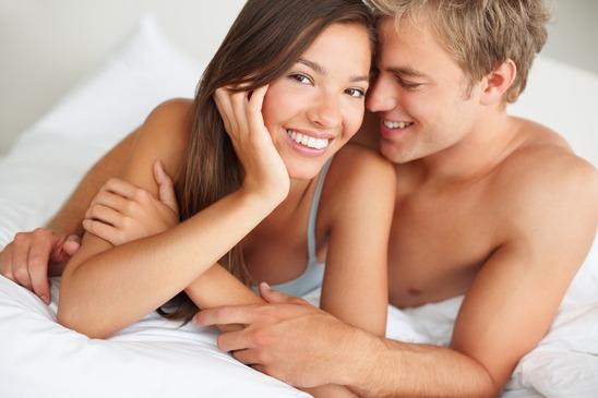 Honeymoon couple enjoying eachother's company on the bed